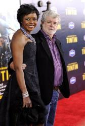 Director George Lucas and girlfriend Mellody Hobson attend the premiere of The Adventures of Tintin at the Ziegfeld Theatre on Sunday, Dec. 11, 2011 in New York.