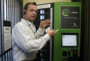 In this April 20, 2012, photo, Joe DeRobbio explains the features of the Autospense, an automated machine his company developed to dispense medical marijuana, in Santa Ana, Calif.