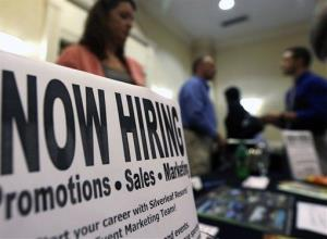In this Thursday, Oct. 25, 2012, photo, a sign attracts job-seekers during a job fair at the Marriott Hotel in Colonie, NY.