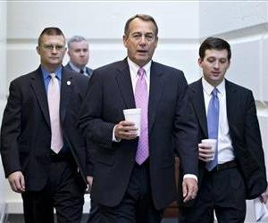 House Speaker John Boehner walks to a strategy session with GOP members on Capitol Hill on Jan. 4.