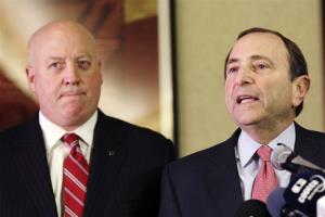 In this Dec. 6, 2012, file photo, NHL Commissioner Gary Bettman, right, and deputy commissioner Bill Daly speak in New York. Bettman has told the players union that a deal must be in place by Jan. 11.