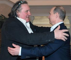 Gerard Depardieu greets Russian President Vladimir Putin after his arrival late Saturday, Jan. 5, 2013, at the president's residence in Sochi, the host city of the 2014 Winter Olympics.