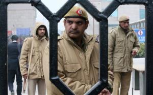 Indian policemen stand guard at the District Court complex where a new fast-track court was inaugurated to deal specifically with crimes against women, in New Delhi, India, Thursday, Jan. 3, 2013.