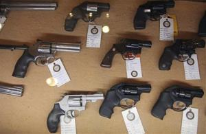 In this Jan. 4, 2013, photo, handguns are displayed in the sales area of Sandy Springs Gun Club and Range, in Sandy Springs, Ga.