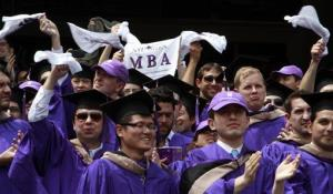 Graduates from the Leonard N. Stern School of Business wave MBA towels as they are declared degree candidates, during NYU's 180th commencement ceremony at Yankee Stadium, May 16, 2012 in New York.