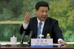 China's newly appointed leader Xi Jinping gestures as he attends a meeting with foreign experts at the Great Hall of the People in Beijing on Wednesday, Dec. 5, 2012.