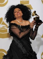 Diana Ross poses backstage with her Lifetime Achievement award at the 54th annual Grammy Awards on Sunday, Feb. 12, 2012 in Los Angeles.