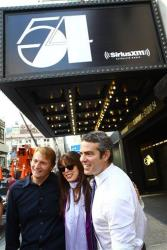 Andy Cohen, right, unveils the Studio 54 marquee outside of the legendary club along with Marc Benecke and Myra Scheer, executive assistant to former Studio 54 co-owner Steve Rubell, on Oct. 11, 2011.