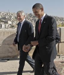 This file photo from July 22, 2008 shows Democratic presidential candidate Sen. Barack Obama, D-Ill., right, walking with Sen. Chuck Hagel, R-Neb., as they tour the citadel in Amman, Jordan.