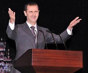 Syrian President Bashar Assad gestures as he speaks, at the Opera House in central Damascus, Syria, Jan. 6, 2013.