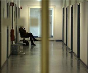 In this March 29, 2012 file photo a woman sits alone in corridor in front of job consultants offices at the employment bureau 'Arbeitsagentur' in Berlin, Germany.