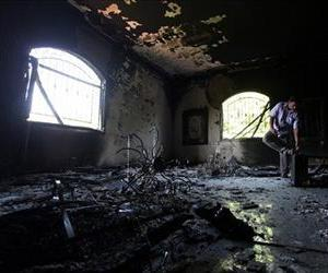 A Libyan man investigates the burned out US consulate in Benghazi in this Sept. 13, 2012 file photo.