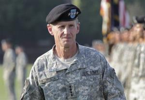 FILE - This July 23, 2010 file photo shows Gen. Stanley McChrystal reviewing troops for the last time as he is honored at a retirement ceremony at Fort McNair in Washington. A memoir by retired Gen. Stanley McChrystal has been delayed pending security clearance from the U.S. Department of...