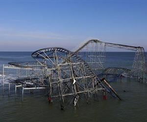 In this Nov. 29, 2012 file photo, a roller coaster that once stood on the Funtown Pier at Seaside Heights is seen dunked in the ocean after the pier was hit by superstorm Sandy in Seaside Heights, NJ.
