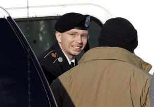 In this Nov. 28 file photo, Army Pfc. Bradley Manning steps out of a security vehicle into a courthouse in Fort Meade, Md.