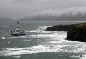 This image provided by the US Coast Guard shows the Royal Dutch Shell drilling rig Kulluk aground off a small island near Kodiak Island, Wednesday Jan. 2, 2013.