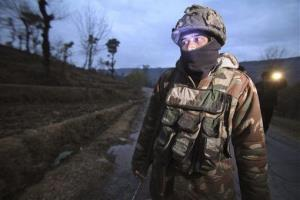 Indian army soldiers patrol near the line of control, the line that divides Kashmir between India and Pakistan.