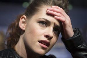 Actress Kristen Stewart talks to media as she attends the German premiere of The Twilight Saga: Breaking Dawn Part II in Berlin, Friday, Nov. 16, 2012.