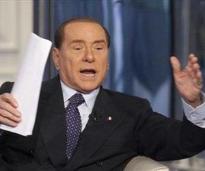 Former Premier Silvio Berlusconi gestures as he is interviewed during a television show recorded in Rome, Italy, Jan. 9, 2013.