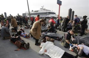Victims of the ferry accident are aided by rescue personnel in New York.