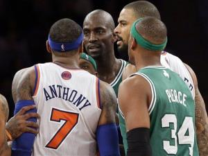 In this photo taken Jan. 7, 2013, New York Knicks' Carmelo Anthony (7) and Boston Celtics' Kevin Garnett, center, exchange words after both received technical fouls at Madison Square Garden in New York.