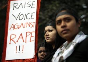 Bangladeshi girls hold placards as they stand to form a human chain to protest against the recent gang rape of a young woman on a moving bus in New Delhi, in Dhaka, Bangladesh, Jan. 9, 2013.