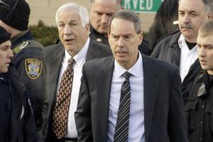 In this Dec. 13, 2011, file photo, Jerry Sandusky walks with his attorney Joe Amendola, center right, as he leaves the Centre County Courthouse in Bellefonte, Pa.