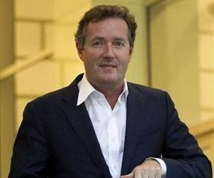 This Tuesday, Dec. 20, 2011 file photo shows Piers Morgan, host of CNN's Piers Morgan Tonight, as he leaves the CNN building in Los Angeles.