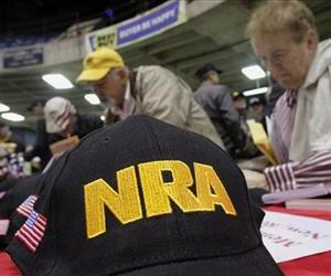 Illinois gun owners and supporters file out NRA applications in this March 7, 2012, file photo.