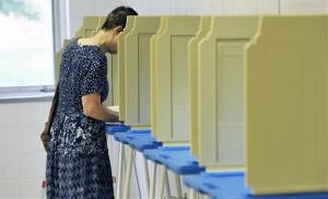 A voter casts her ballot on Aug. 14, 2012, in Bloomington, Minn.