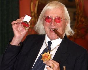 This 2008 file photo shows Jimmy Savile displaying a medal in London.