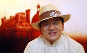 Jackie Chan smiles during a press conference to promote his new movie CZ12 in Kuala Lumpur, Malaysia, Sunday, Dec. 16, 2012.