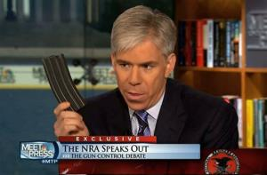 This image made from video provided by NBC's Meet the Press shows host David Gregory holding a high-capacity ammunition magazine.