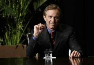 Robert F. Kennedy Jr., left, makes comments during the opening minutes of an interview with journalist Charlie Rose.