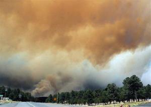 In this file photo taken June 9, 2012, smoke billows from the Little Bear fire in southeastern New Mexico.