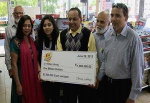 This June 2012 photo shows Urooj Khan, center, holding his $1 million lottery check with his family. At left is Khan's wife, Shabana Ansari.