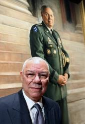 Gen. Colin Powell poses for a photo with his portrait at the Smithsonian's National Portrait Gallery on Sunday, Dec. 2, 2012 in Washington, DC.