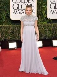 Actress Kristen Bell arrives at the 70th Annual Golden Globe Awards at the Beverly Hilton Hotel on Sunday Jan. 13, 2013, in Beverly Hills, Calif.