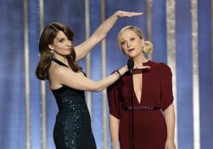 This image released by NBC shows co-hosts Tina Fey, left, and Amy Poehler on stage during the 70th Annual Golden Globe Awards held at the Beverly Hilton Hotel on Sunday, Jan. 13, 2013.
