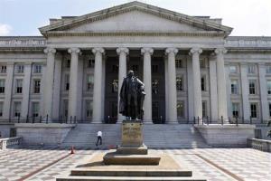 A statue of former Treasury Secretary Albert Gallatin stands outside the Treasury Building in Washington.
