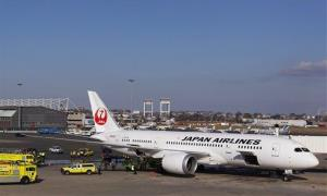 A Japan Airlines Boeing 787 Dreamliner jet aircraft is surrounded by emergency vehicles while parked at a terminal E gate at Logan International Airport in Boston last week.