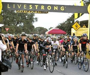 Bike riders begin their 100 mile ride at the Livestrong Challenge Austin bike ride, Oct. 21, 2012, in Austin, Texas.