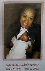 This Dec. 6, 2012 file photo shows  Kasandra Perkins and her daughter Zoey. Jovan Belcher fatally shot Perkins on Dec. 1, 2011, in their Kansas City home, then killed himself.