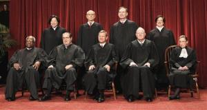Seated from left are Associate Justices Clarence Thomas, and Antonin Scalia, Chief Justice John Roberts, Associate Justices Anthony M. Kennedy and Ruth Bader Ginsburg.