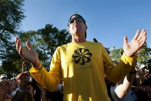 In this Aug. 29, 2012, file photo, Lance Armstrong talks to supporters prior to a run on Mont Royal Park in Montreal.