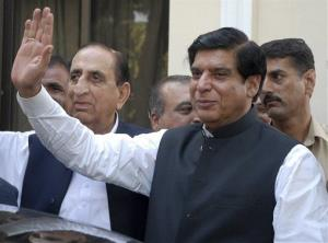In this Friday, June 22, 2012 file photo, Pakistan's Prime Minister Raja Pervaiz Ashraf waves in Islamabad, Pakistan.
