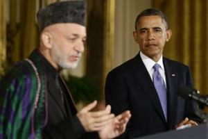 President Barack Obama listens as Afgan President Hamid Karzai speaks during their joint news conference in the East Room at the White House in Washington, Friday, Jan. 11, 2013.