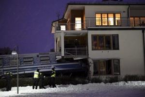 Emergency services attend the scene after a  derailed train crashed into the side of a  residential building in Saltsjobaden outside Stockholm, Tuesday  Jan, 15, 2013.