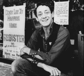 In a Nov. 9, 1977 file photo, Harvey Milk poses in front of his camera shop in San Francisco.