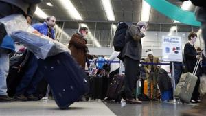 Travelers line up for ticketing at O'Hare airport in Chicago in December.